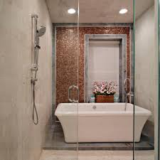 transitional spa bathroom features freestanding bathtub
