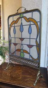 antique english leaded stained glass window brass fire screen stand art deco