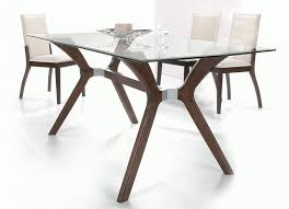 dark walnut rectangular dining table with four cream chairs