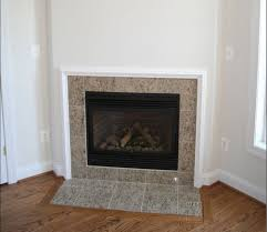 Fireplace with simple builder grade moulding around tile...actually a chair  rail