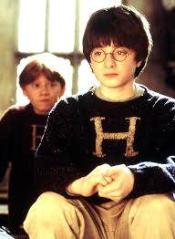 Harry and Ron wearing knitted sweaters made by Mrs. Weasley ...
