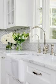 farmhouse sink with white and gray marble counter