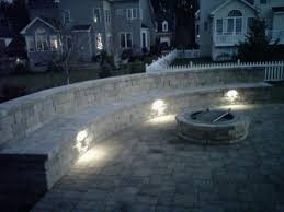 outdoor couch and fire pit with lights