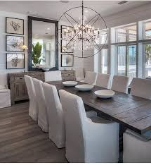 contemporary mirrors for dining room. modern coastal dining room with tongue and groove wall paneling, slipcovered linen chairs wide plank floors. contemporary mirrors for