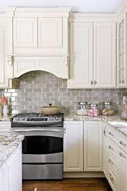 caulking kitchen backsplash. Grey Glass Subway Tile Backsplash Ideas For Small Kitchen With White Cabinet Set And Wooden Floor Caulking P