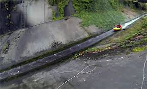 drainage ditch video of man kayaking down a drainage ditch surfaces