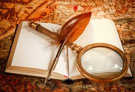 vine still life magnifying gl old book and goose quill pen lying on an old map in 1565