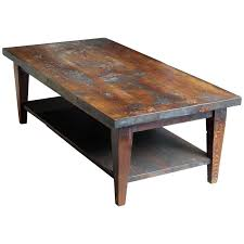 reclaimed semi rustic pine coffee table with bottom shelf and tapered legs for