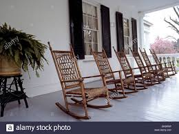 rocking chairs made of wood and wicker await visitors on the front porch of the classic 1830s rosedown plantation in st francisville louisiana usa