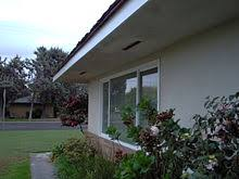 Wide eaves of a typical ranch house, this one built in 1966 in California
