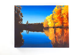 fall trees painting over river