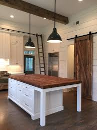 shiplap wall kitchen. kitchen island, lights, barn door, ship lap, beams shiplap wall s