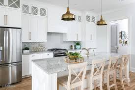 gray granite kitchen countertops with white herringbone tile backsplash