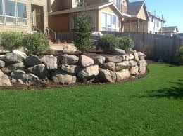retaining wall grass lawn green boulders rock french backyard discovery landscape walls gallery