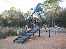 The zip line at New Tampa Nature Park is a featured attraction for children  visiting the  Outdoor PlaygroundPlayground IdeasTampa ...