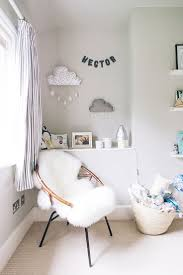 A modern stylish unisex baby nursery with a neutral grey colour scheme.