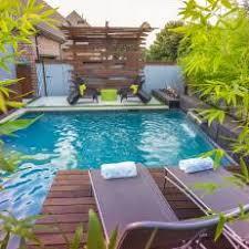 Rusted corrugated metal fence Privacy Corrugated Metal Fence Surrounding Backyard Pool Area Photos Hgtv Photos Hgtv