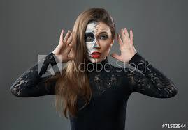 surprised woman with makeup skeleton