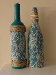 Lace, pearl, and twine adorned teal wine bottles, set of two