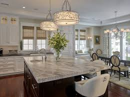 classic kitchen i love the window seat in the dining area and the light fixtures over the center island are gorgeous
