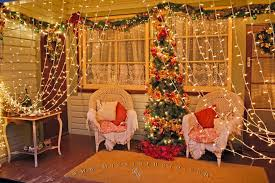 Photo of Christmas scene on house porch decorated with festive lights in  Pukeuri, Otago, New Zealand