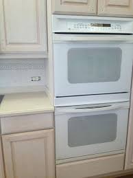 cream colored kitchen cabinets with white appliances kitchen cabinets with white appliances kitchens with dark cabinets