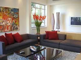 cool simple home decorating ideas living room design with dark gray sofa and red cushion also black gloss rectangle home office