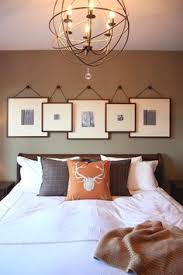 above bed lighting love the overlapping frames master bedroom or maybe in living room above bed lighting