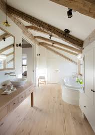 view in gallery bright and rustic attic bathroom