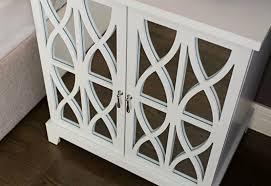 hamptons style cabinet with geometric panelirror