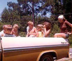 Riding in the back of pickup trucks . . . how much fun and now you'd ...