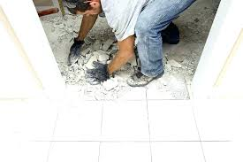 remove vinyl adhesive from cement floor how