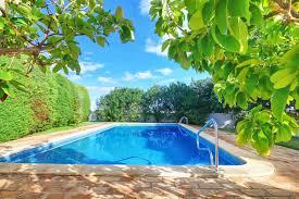 fiberglass inground pool installation in residential backyard with custom pool landscaping