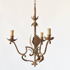 antique spanish chandelier made in iron with leaves and funky arms