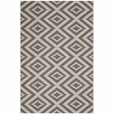 jagged geometric diamond trellis 8x10 indoor and outdoor area rug in gray and beige