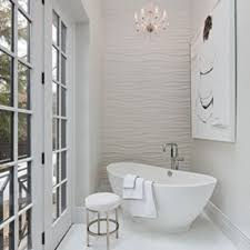 bathroom remodeling washington dc. a washington, dc home gets master bathroom remodel. the new space features freestanding tub, wave-like wall panel, bow-front vanity, and curbless shower remodeling washington dc