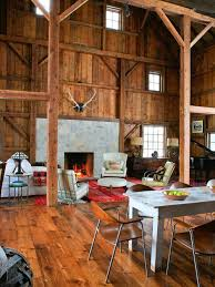 Example of a mountain style living room design in Detroit with a stone  fireplace