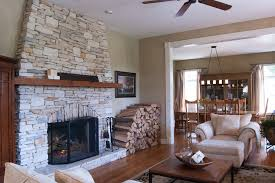 splashy tommy bahama bedding in living room farmhouse with reface fireplace with stone next to fireplace hearth