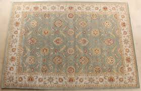 rug257 10 x 14 traditional indian sea green and light gold hand tufted