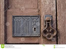 old church door with handle and lock