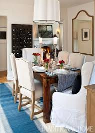 feel casual dining room design a rustic wood table paired with white nailhead trimmed chairs sits ato