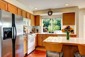 White Appliances In Kitchen Cozy Kitchen With Honey Color Cabinets White Appliances And