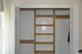 furniture brown wooden wall closet with racks on white wall completed by white wooden folding