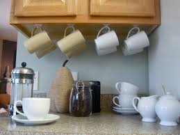 simple command hooks under the cabinets display your mug collection and  free up valuable cupboard space!