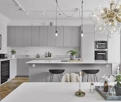 I was certain I wanted white but now I'm thinking light grey cabinetry for  my next kitchen, doesn't it look great with the marble benchtops and black  + ...