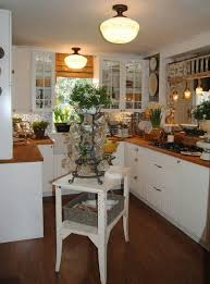 kitchen lighting country style using flush mount lamp shades above pedestal cake stand with dome cover beautiful kitchen lighting