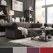 Tufted Scroll Arm Chesterfield couch with coffee table and rug for living  room decoration ideas