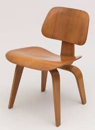 form constructed of five shaped pieces of laminated and bent wood contoured tzoidal seat and