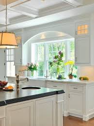 sink windows window love: arched detail over sink coffered ceiling farmhouse kitchen sink counter flush with window