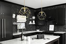 white himalaya marble countertops black tile kitchen